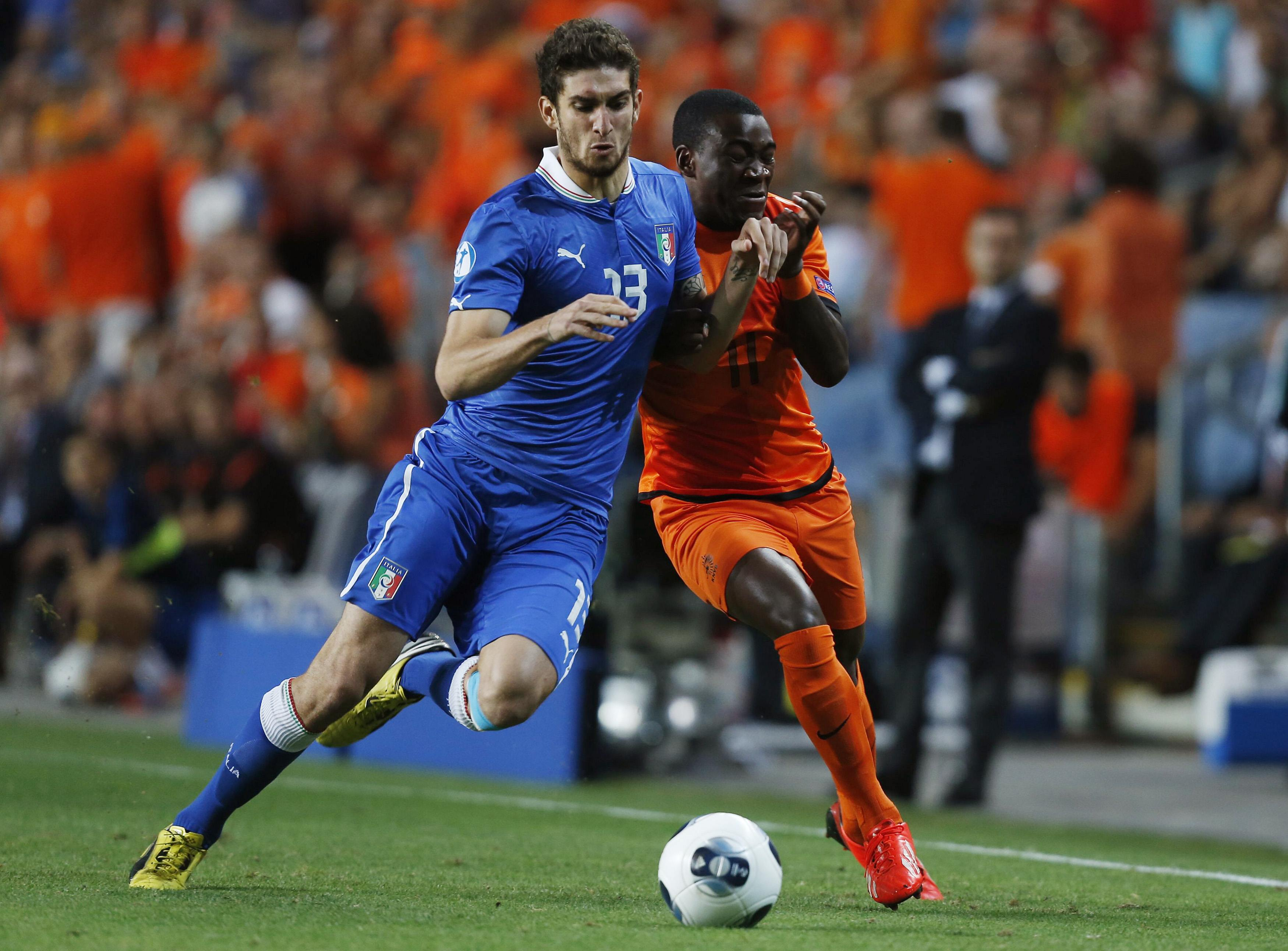 Matteo Bianchetti of Italy fights for the ball with Ola John of the Netherlands during their semi-final European Under-21 Championship soccer match in Petah Tikva