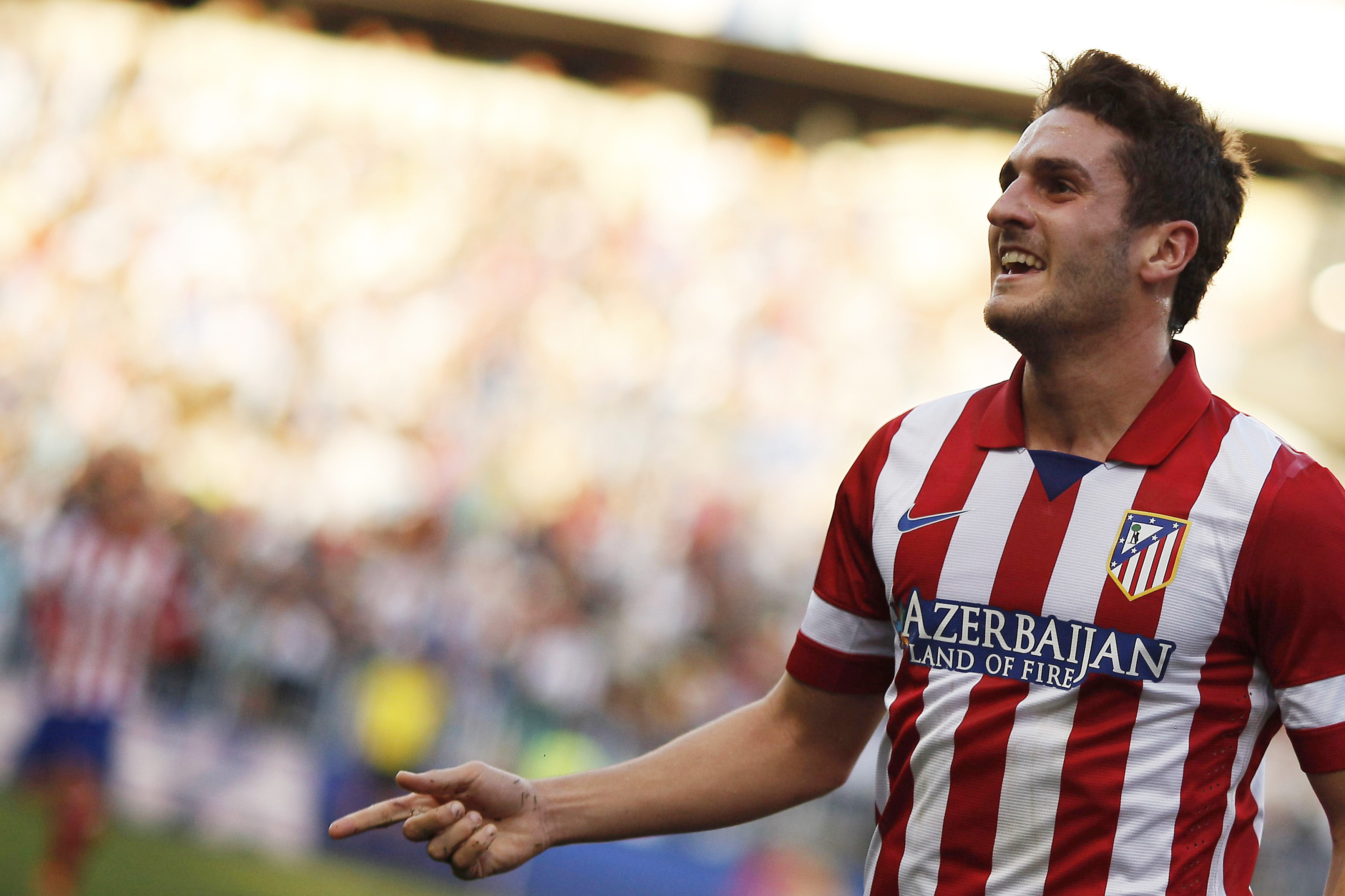Atletico Madrid's Koke celebrates after scoring a goal against Malaga during their Spanish First Division soccer match in Malaga