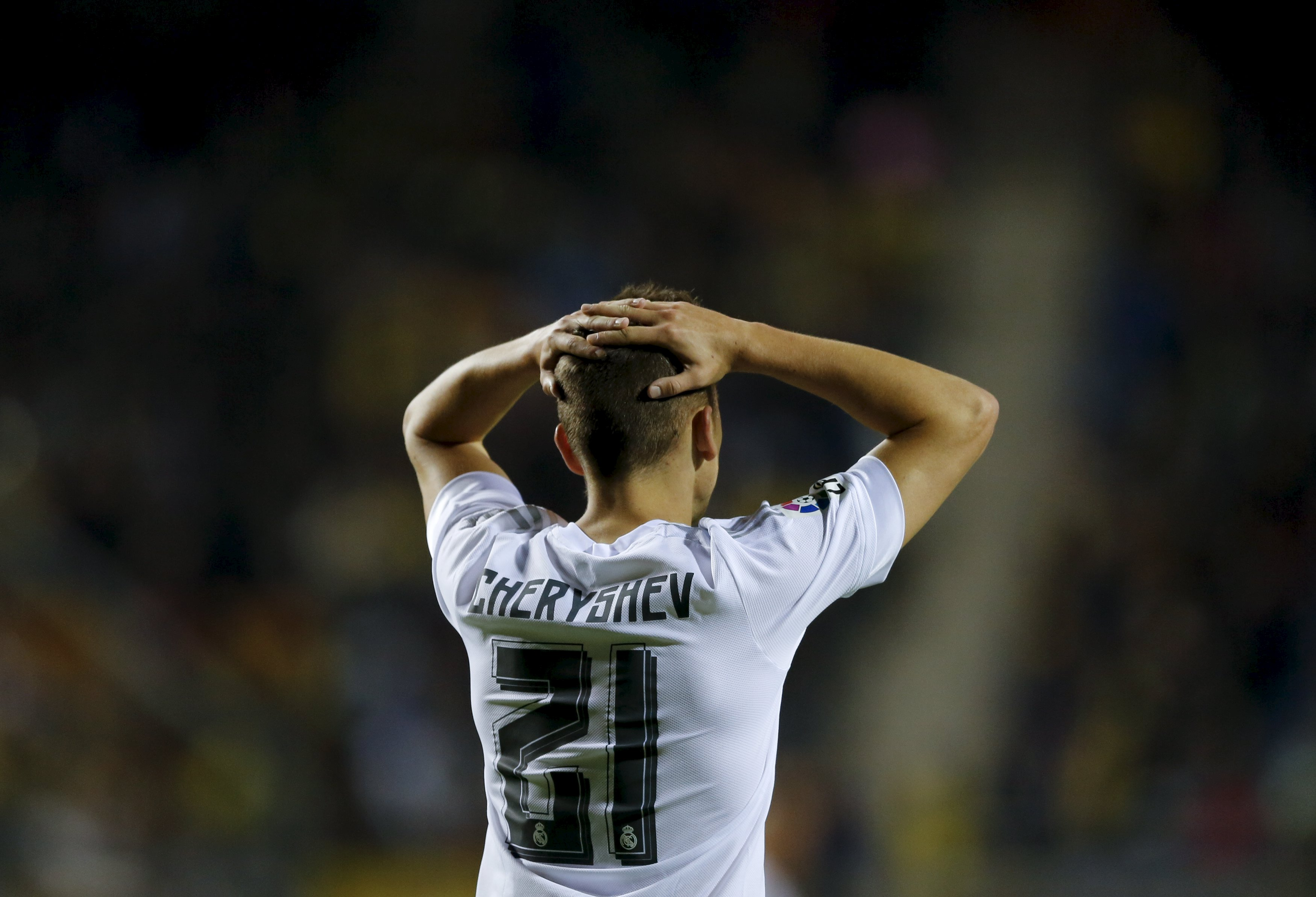 Real Madrid's Cherishev laments after missing a scoring opportunity against Cadiz during a soccer match in Cadiz, southern Spain