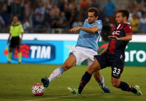 Lazio's Lulic challenges Brighi of Bologna during Italian Serie A soccer match in Rome