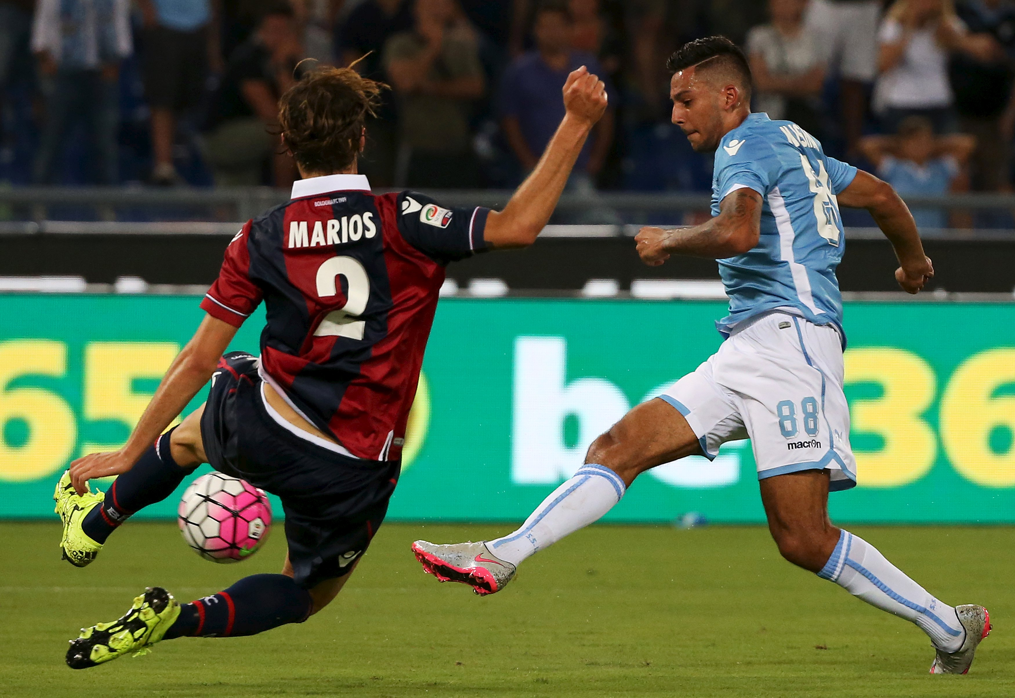 Lazio's Kishna kicks the ball as Morleo of Bologna tries to stop it during their Italian Serie A soccer match