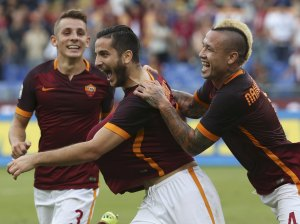 AS Roma's Manolas celebrates after scoring with teammates Nainggolan and Digne during their Italian Serie A soccer match against Carpi in Rome