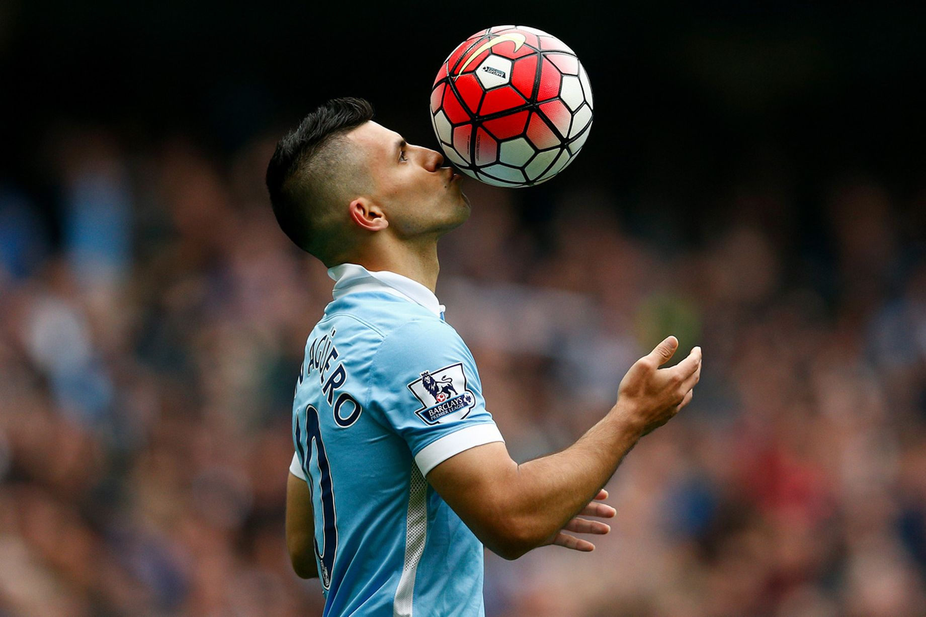 Sergio-Aguero-kisses-the-ball-to-celebrate-his-hat-trick