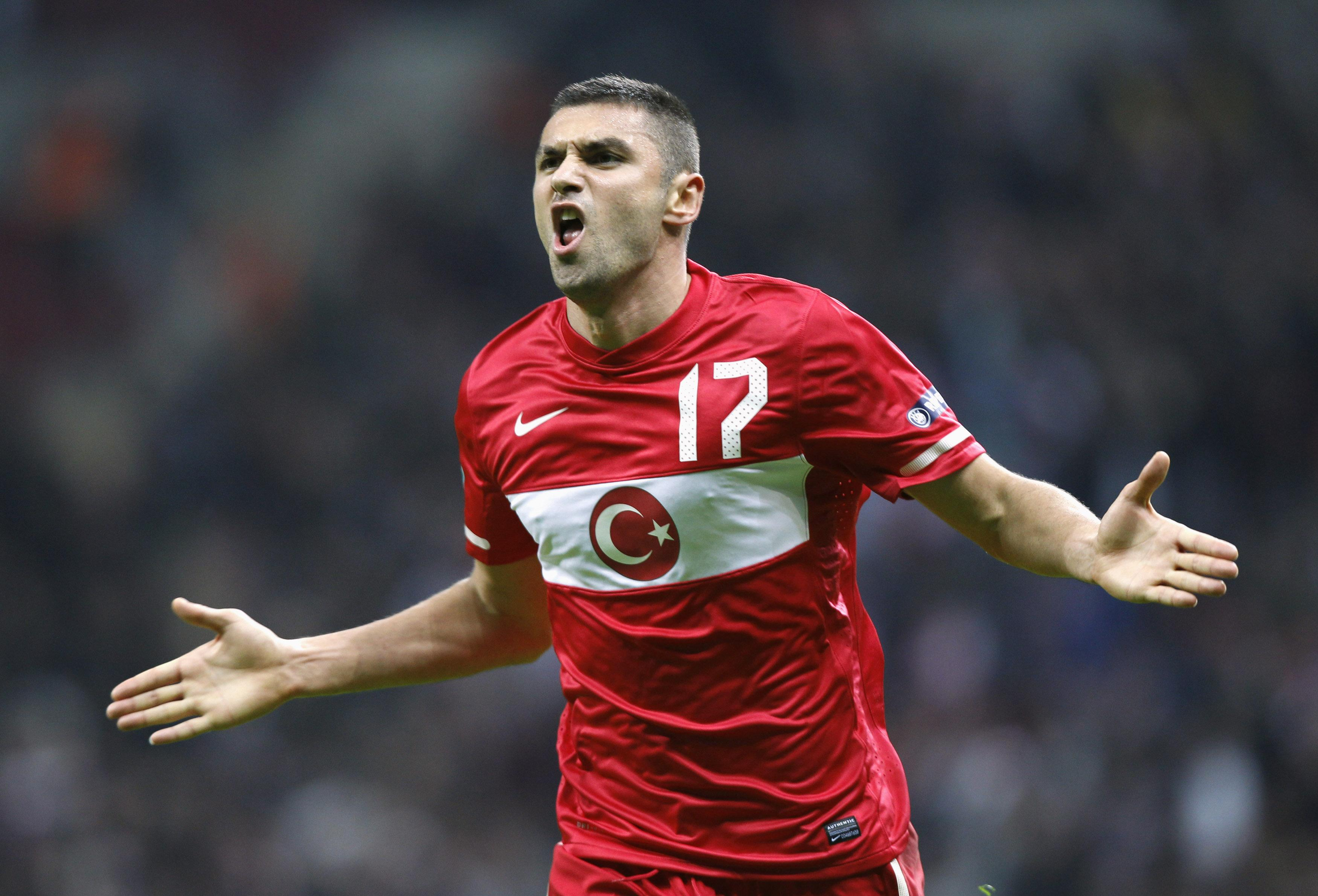 Turkey's Burak Yilmaz celebrates after scoring a goal against Azerbaijan during their Euro 2012 qualifying Group A soccer match at Turk Telekom Arena in Istanbul
