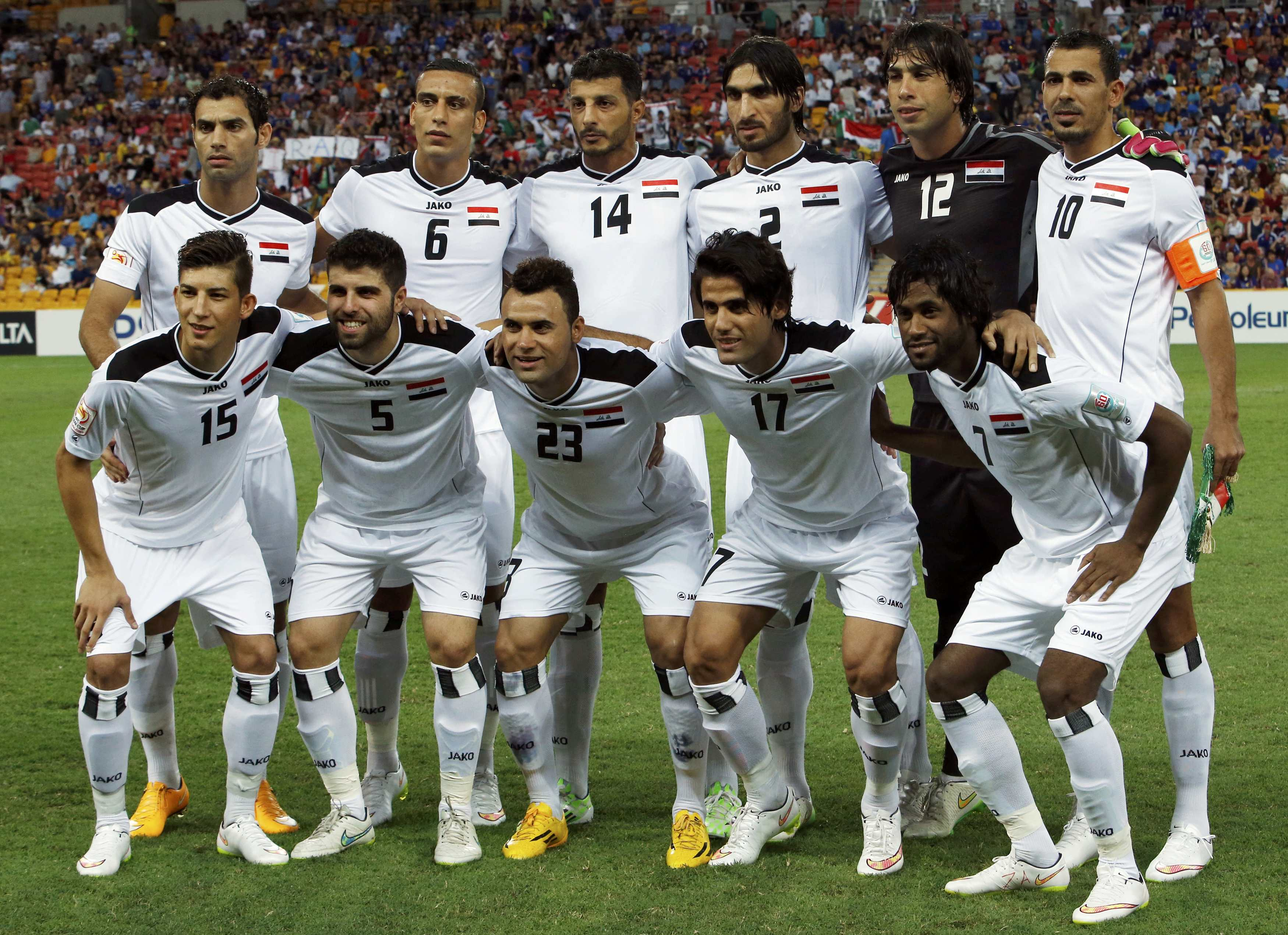The Iraq team poses for a photo before their Asian Cup Group D soccer match against Japan at the Brisbane Stadium in Brisbane