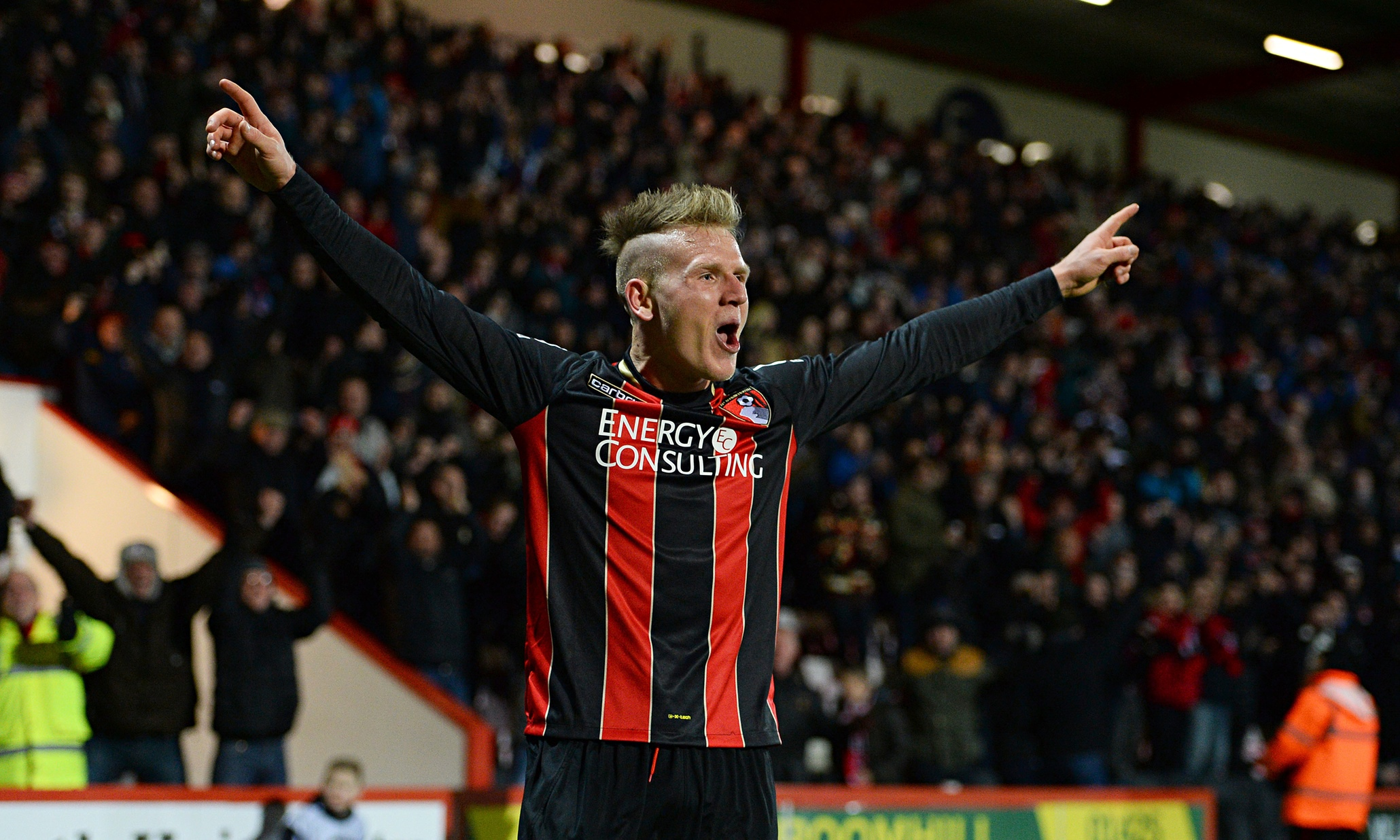 Matt Ritchie celebrates after he scores Bournemouth's second goal against Watford