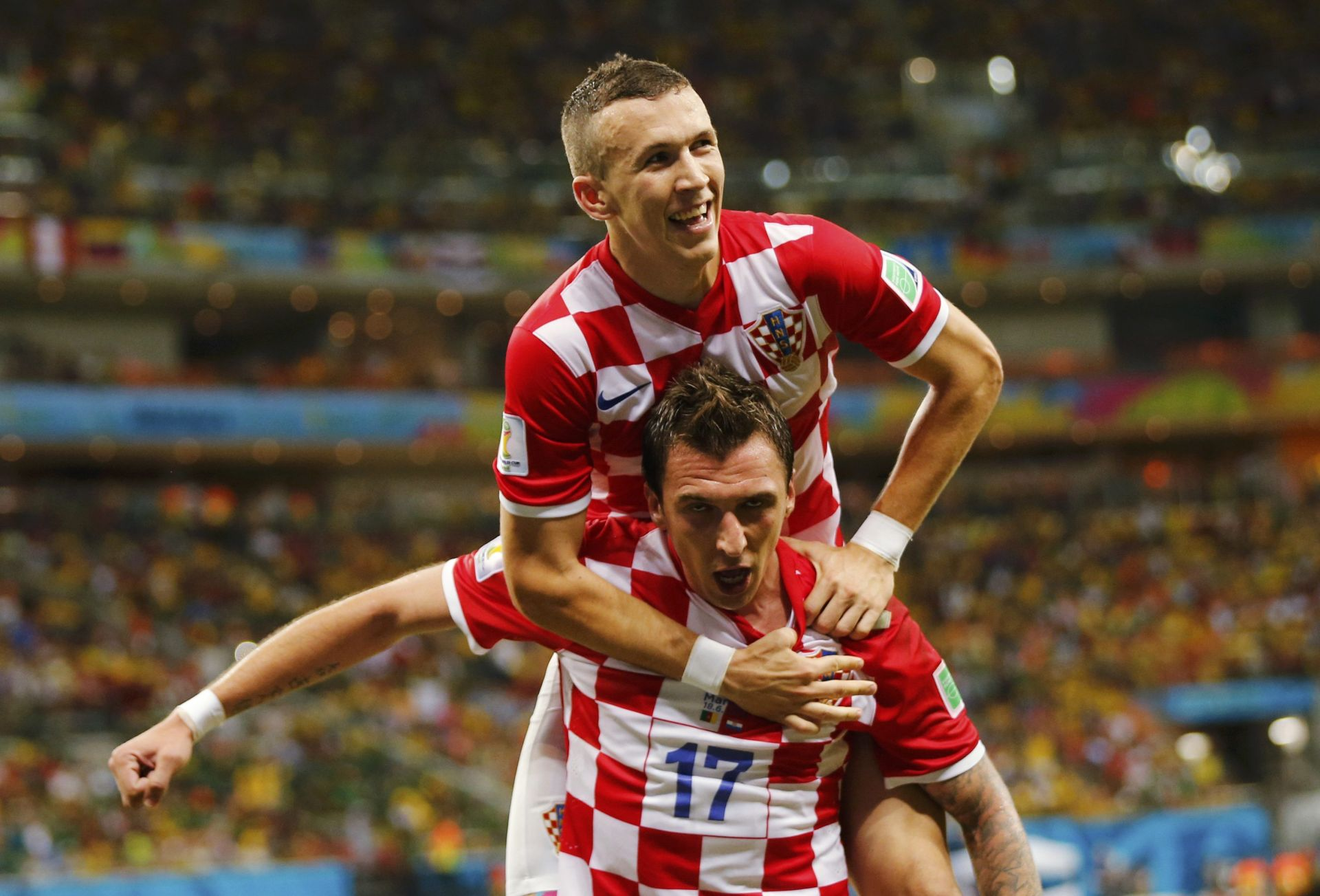 Croatia's Mandzukic celebrates after scoring a goal with teammate Perisic during their 2014 World Cup Group A soccer match against Cameroon at the Amazonia arena in Manaus
