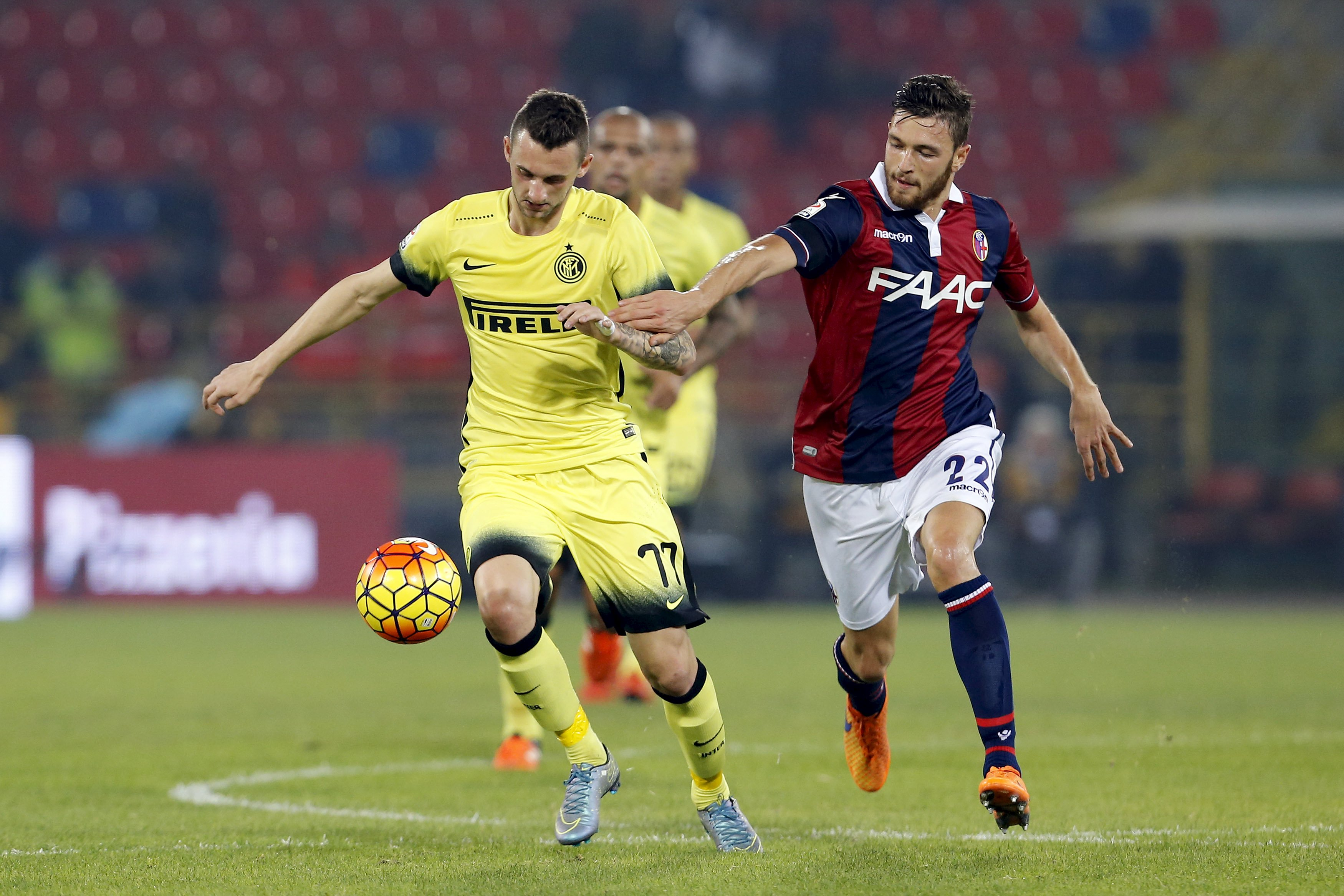 Inter Milan's Brozovic and Bologna's Rizzo fight for the ball during their Serie A soccer match in Bologna