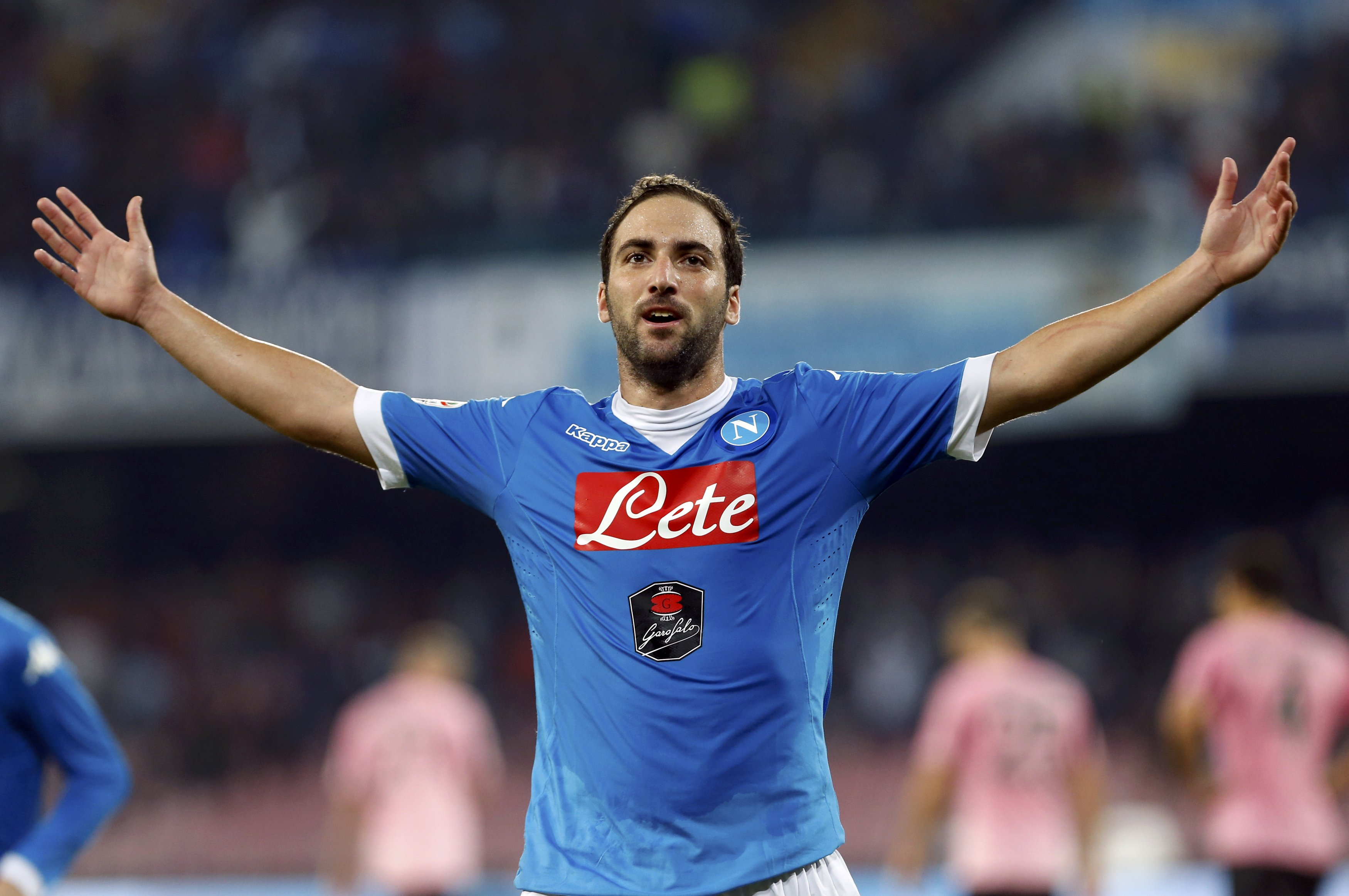 Napoli's Higuain celebrates after scoring against Palermo's during their Serie A soccer match at San Paolo stadium in Napoli