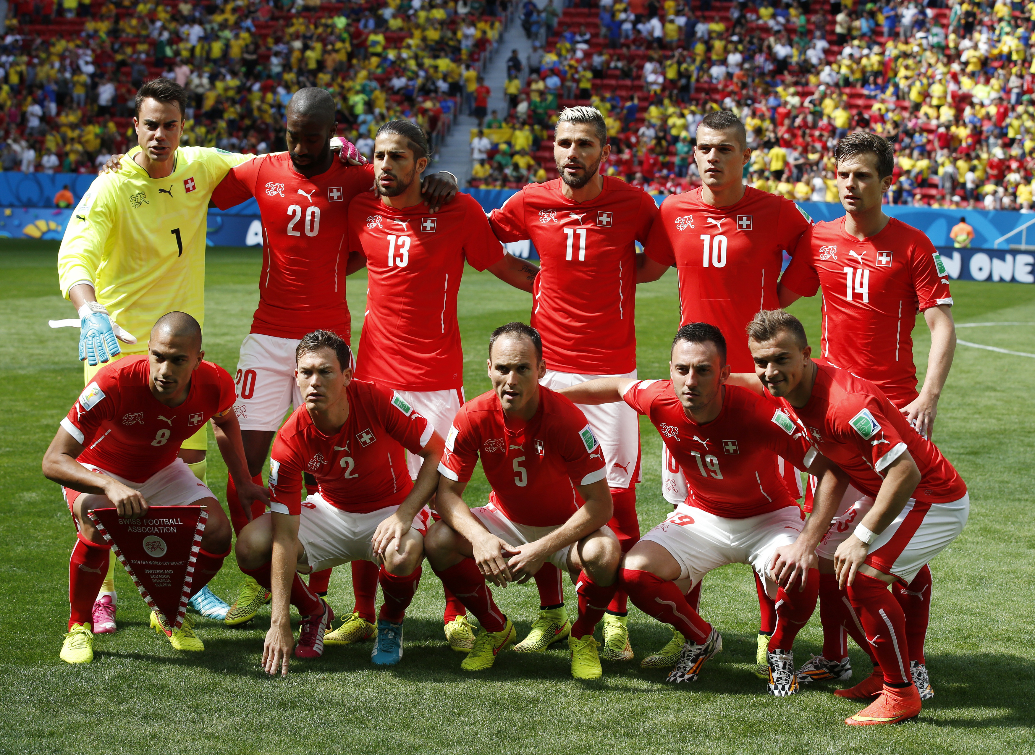 Switzerland's national soccer players pose for a team photo before their 2014 World Cup Group E soccer match against Ecuador at the Brasilia national stadium in Brasilia