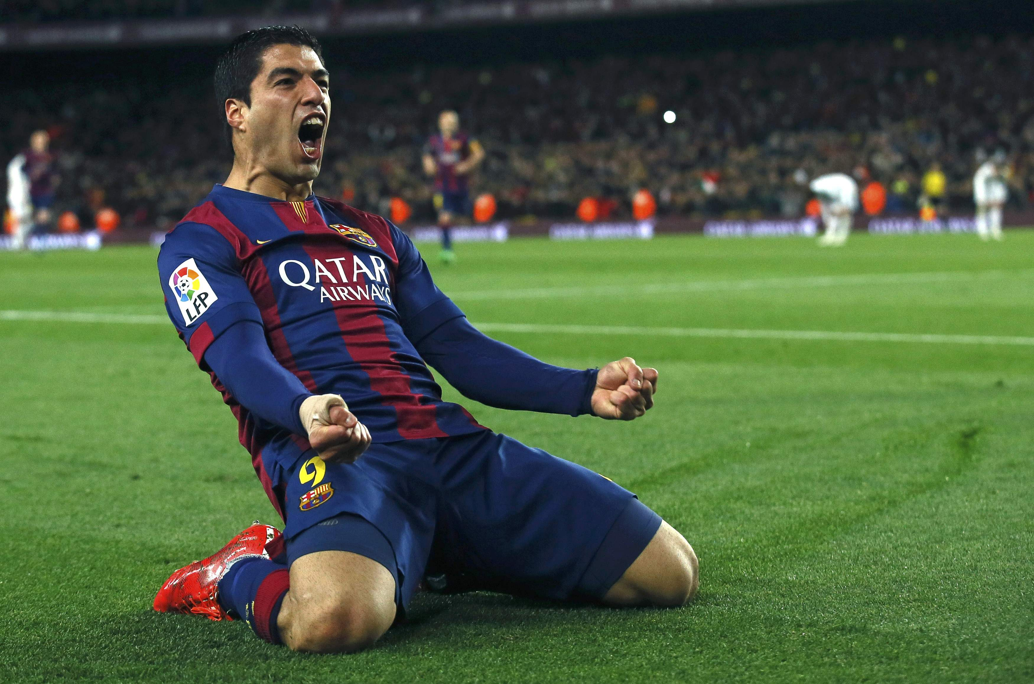 """Barcelona's Suarez celebrates after scoring a goal against Real Madrid during their Spanish first division """"Clasico"""" soccer match at Camp Nou stadium in Barcelona"""
