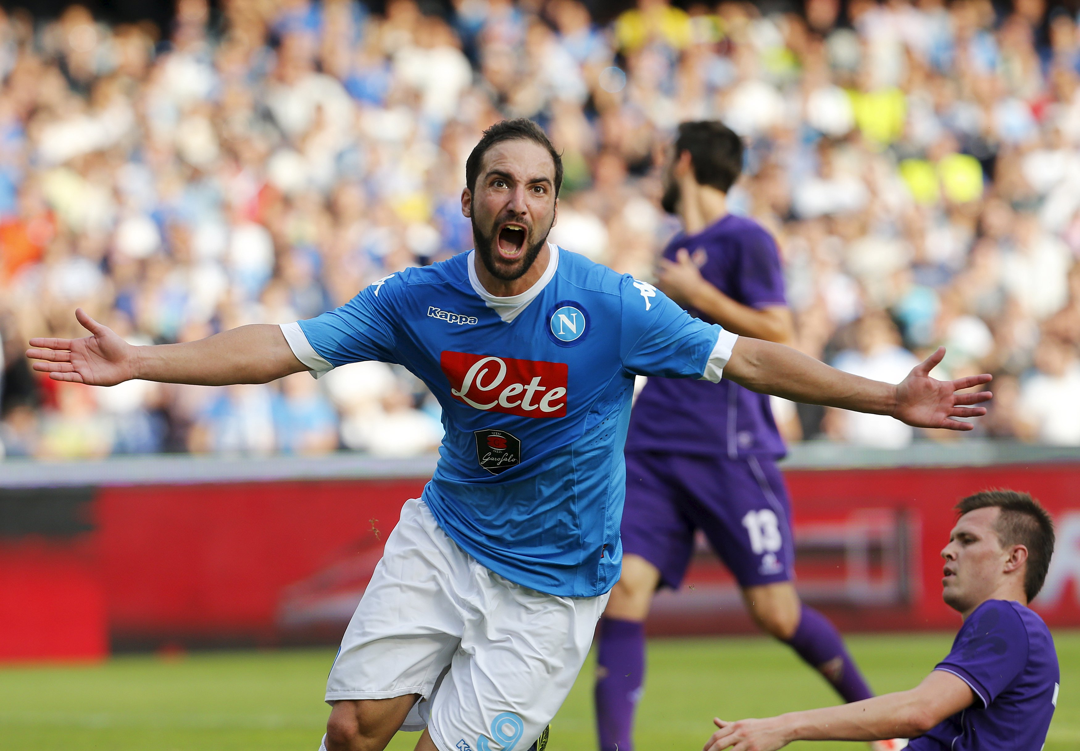Napoli's Gonzalo Higuain celebrates after scoring against Fiorentina during their Italian Serie A soccer match in Naples