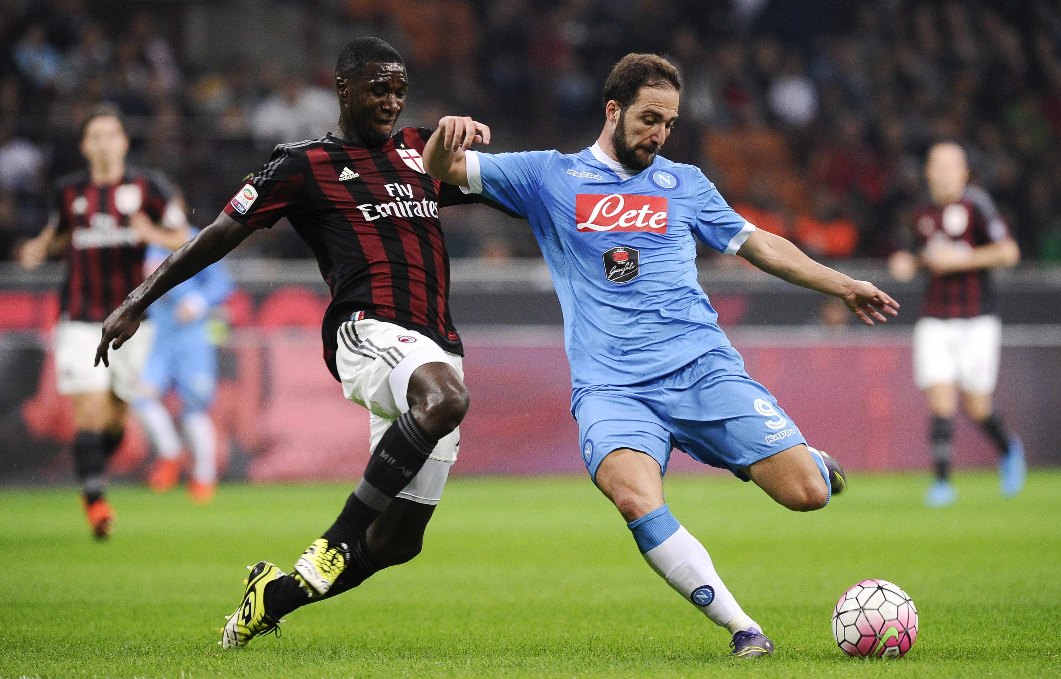 AC Milan's Zapata challenges Napoli's Higuain during their Italian Serie A soccer match at the San Siro stadium in Milan