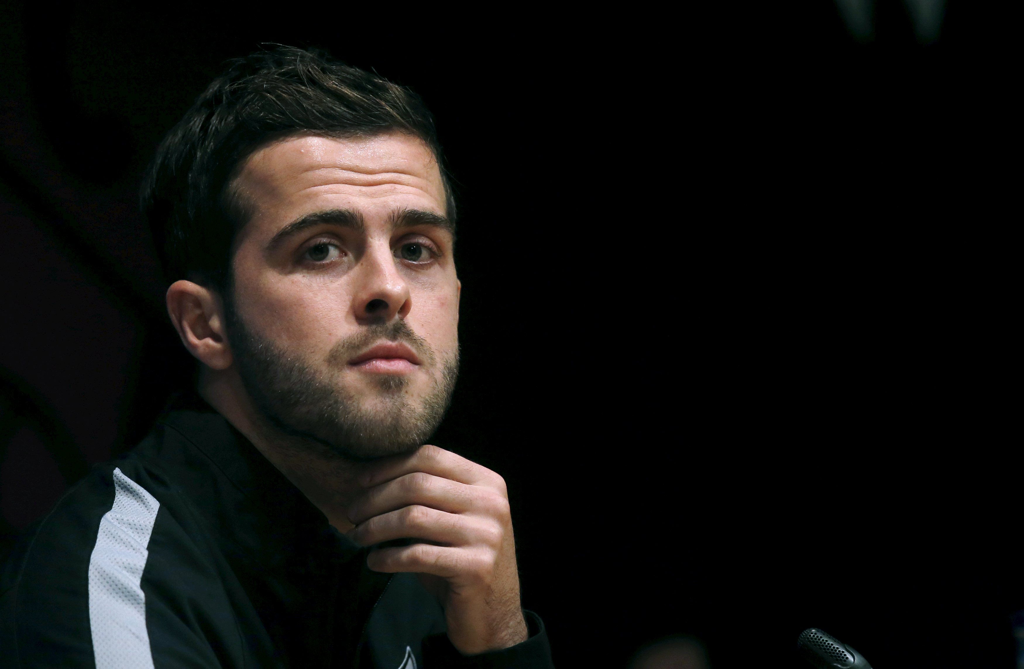 AS Roma's player Pjanic attends a news conference, a day ahead of their soccer Champions League match against FC Barcelona, at Camp Nou stadium in Barcelona
