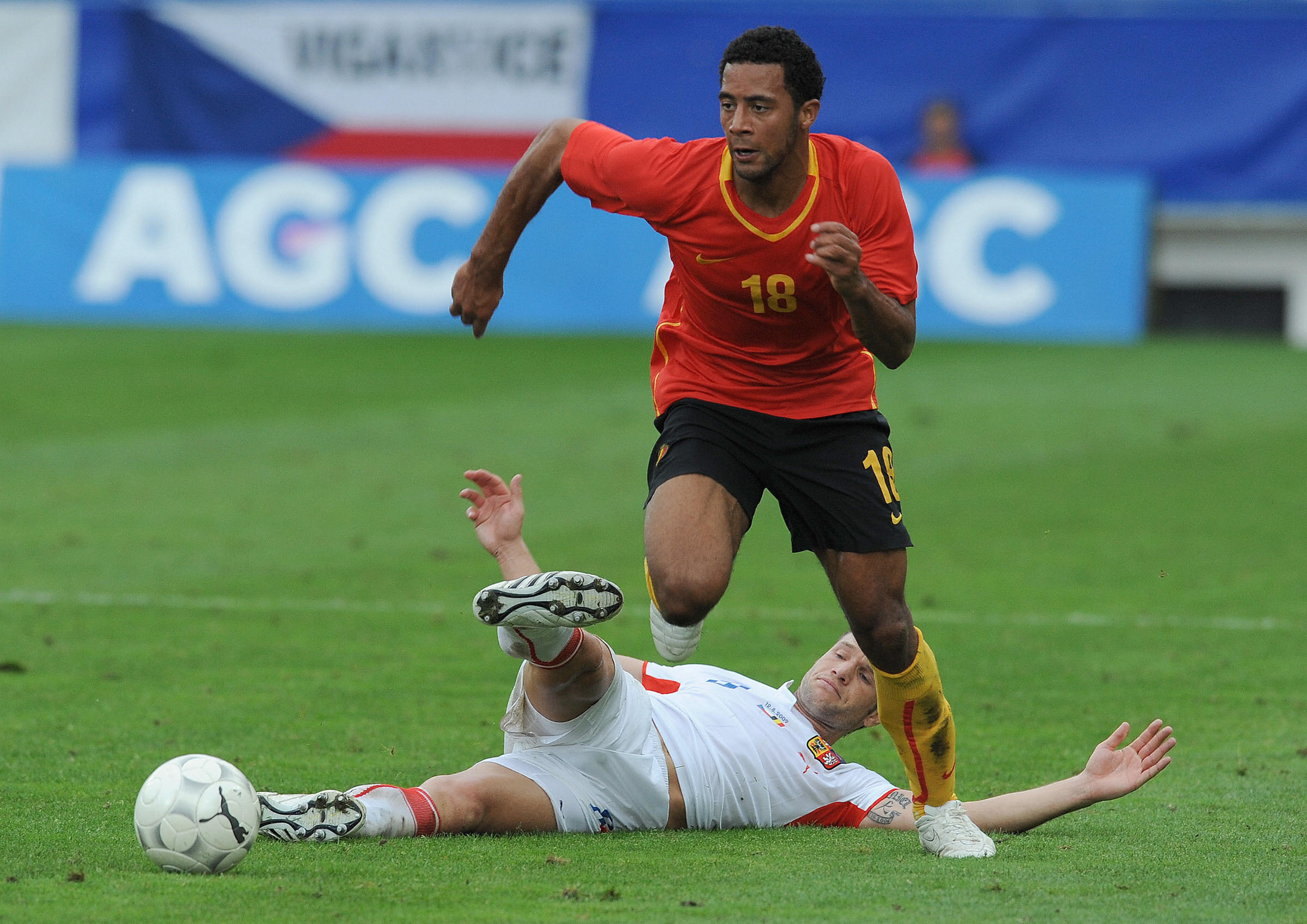 Mousa Dembele of Belgium (top) runs past