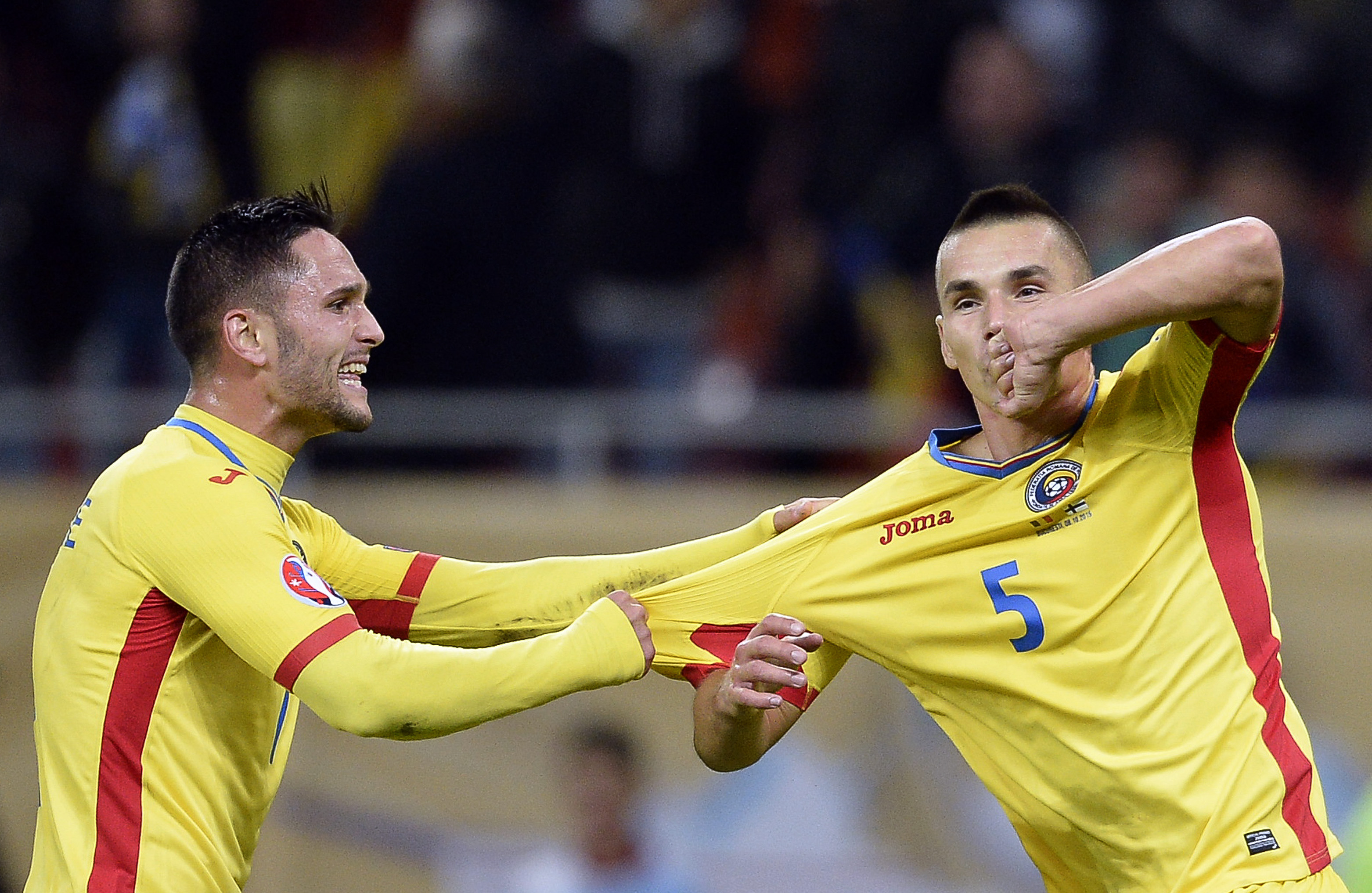 Romania's Hoban celebrates his goal against Finland with team mate Andone during their Euro 2016 Group F qualification soccer match in Bucharest