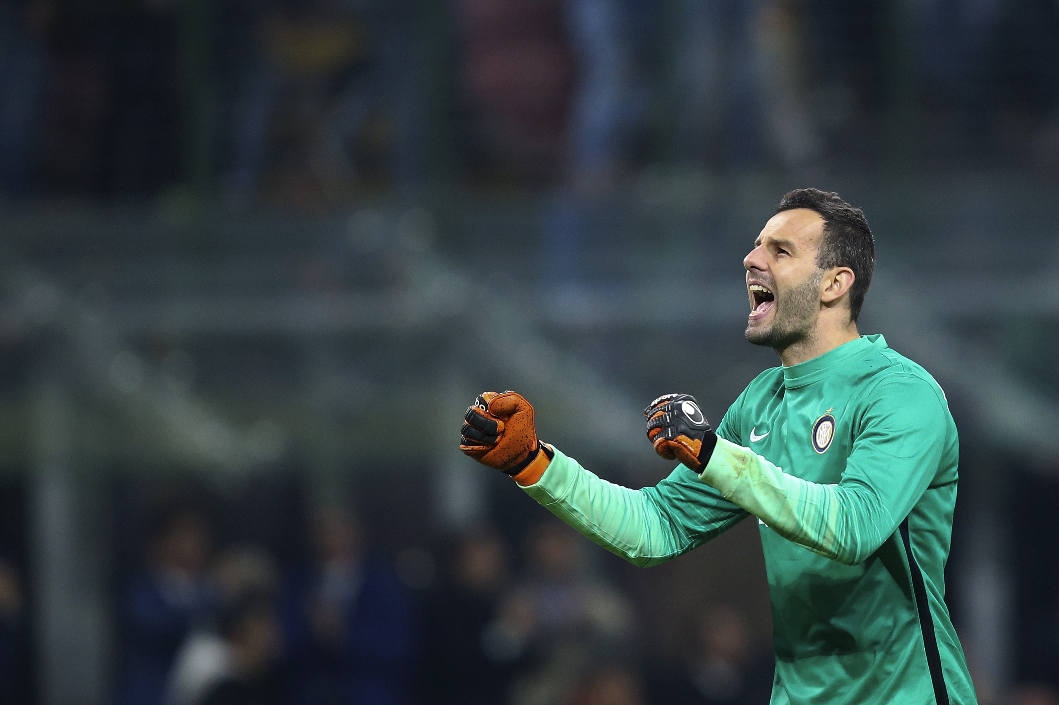 Inter Milan's goalkeeper Handanovic celebrates at the end of their Italian Serie A soccer match against AS Roma at the San Siro stadium in Milan