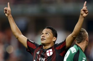AC Milan's Bacca celebrates after scoring against Empoli during their Serie A soccer match in Milan