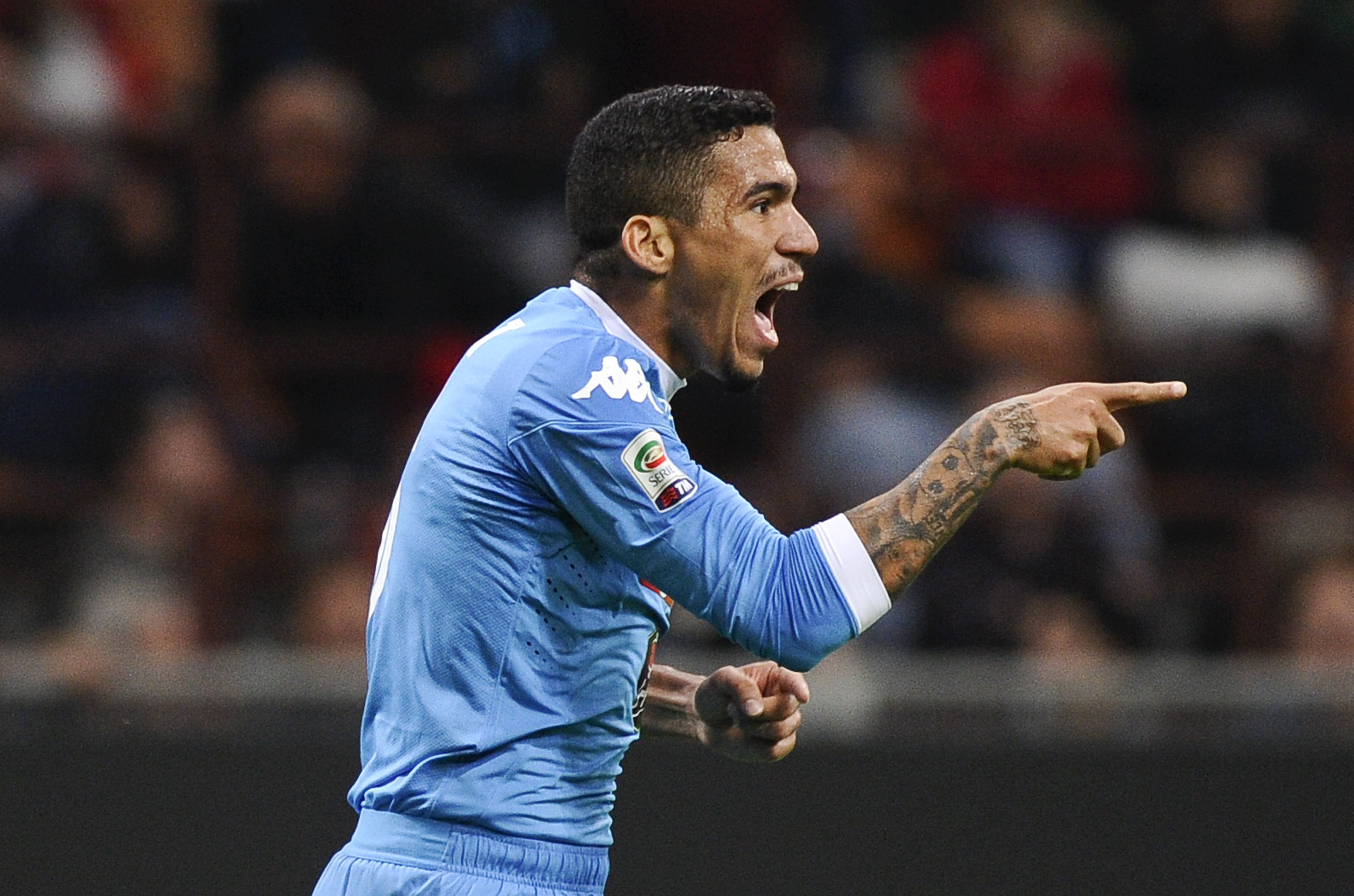 Napoli's Allan celebrates after scoring against AC Milan during their Italian Serie A soccer match at the San Siro stadium in Milan