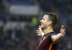 AS Roma's Dzeko celebrates after scoring against Leverkusen's during their Champions League soccer match  in Rome