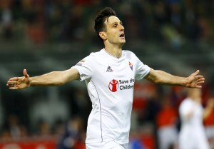 Fiorentina's Nikola Kalinic celebrates after scoring during the Italian Serie A soccer match against Inter Milan in Milan