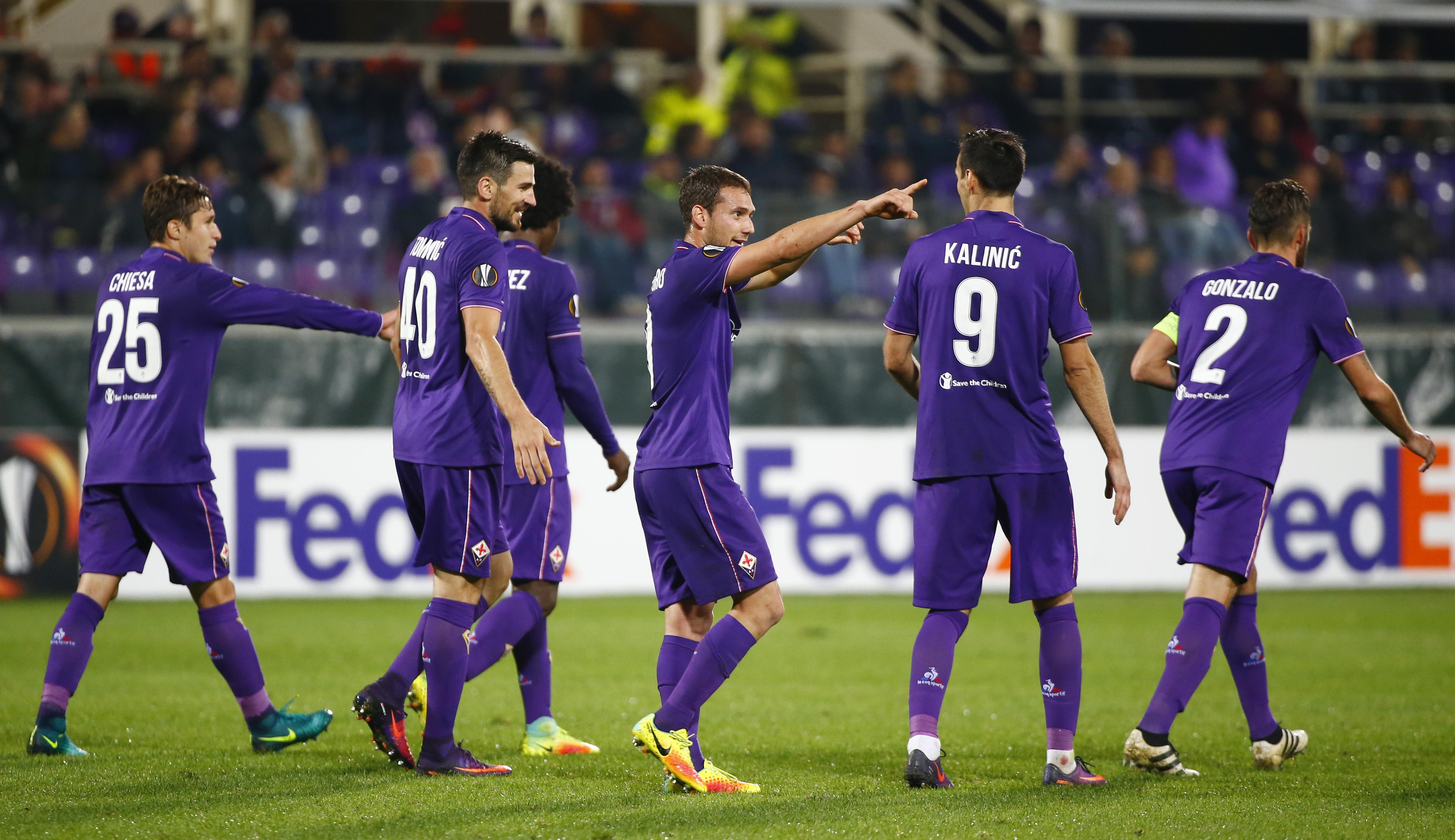 Fiorentina's Sebastian Cristoforo celebrates scoring their third goal with teammates